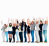 Group of friends standing in a row with hands raised against whi