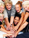 Group of smiling friends with hands on hands