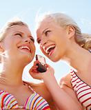 Portrait of young pretty girls with a mobile phone