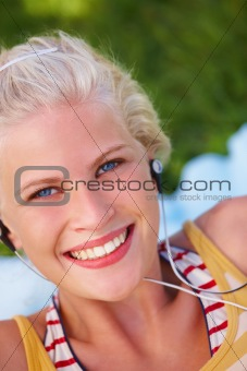 Closeup of a happy pretty girl with earphones