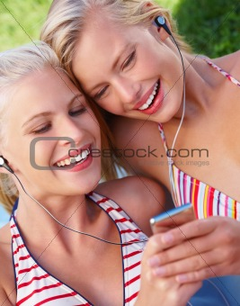 Closeup of happy pretty women listening to music