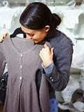 Closeup of a young lady purchasing clothes in store