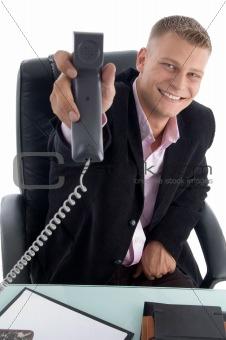 sitting handsome businessman