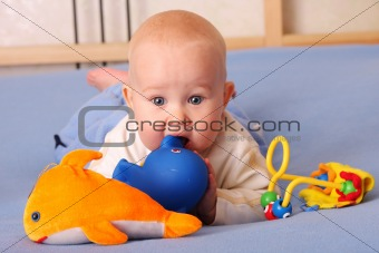 Baby plays with toys 2