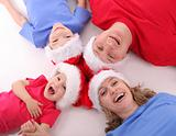 Happy family in Christmas hats 5