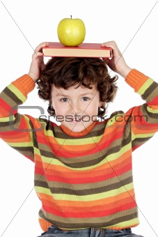 Adorable child studying with books and apple in the head