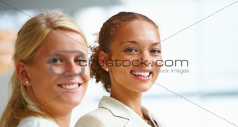 Closeup of happy young business women smiling
