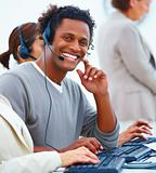 Closeup of a happy male executive with headset using headset