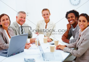 Happy colleagues having a business meeting against white backgro