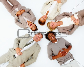 Portrait of happy business people lying on white