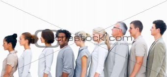 Business people standing in a line and a business man smiling