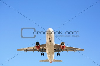 airplane overhead against blue sky