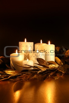 White candles with gold leaf garland