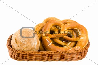 bread basket with pretzel isolated on white