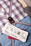 boarding pass passport on suitcase