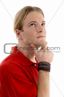 smart young man thinking and looking sideways