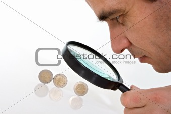 Man having a close look on euro coins