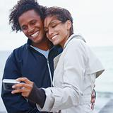 Portrait of a young couple taking a photograph
