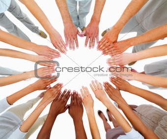 People standing with hands in a circle