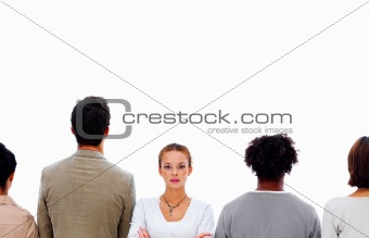 Portrait of business woman standing and other business people