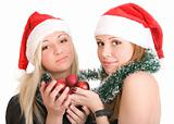Two girls in Santa hats