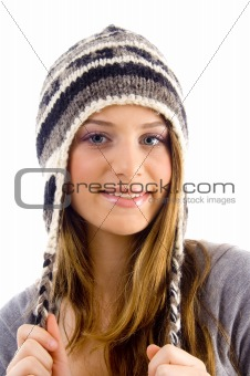 portrait of attractive female wearing woolen cap
