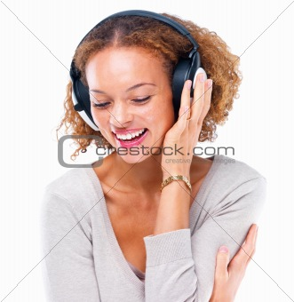 Closeup of a laughing young girl listening to music isolated on