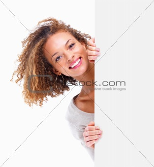 Portrait of a young woman by a blank board isolated on white bac
