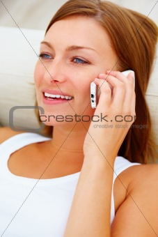 Closeup portrait of a beautiful lady smiling and talking on a ce