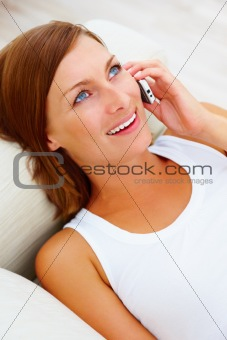 Top view of a beautiful girl talking on a cellphone