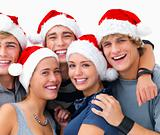 Portrait of young friends celebrating Christmas 