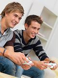 Closeup portrait of two friends playing video game