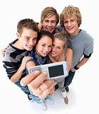 Top view of happy teenagers taking self portrait 
