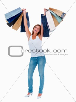 Beautiful woman holding shopping bags on white background