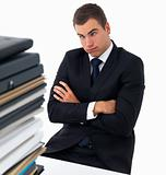 Exhausted business man with a stack of files