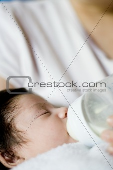 mother feeding newborn baby