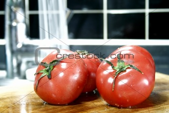 Tomatoes with running water