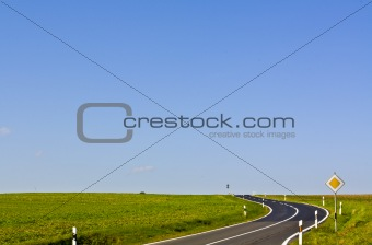 Country road and big blue sky