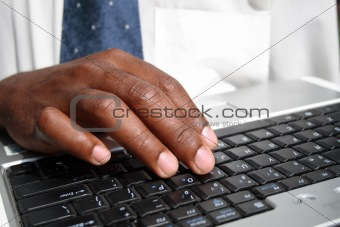 african businessman working on computer