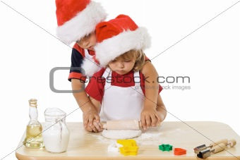 Little boy and girl making christmas cookies