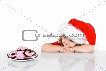 Little girl at christmas time with cookies