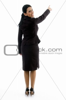 back pose of businesswoman indicating