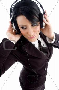 young employee holding headphone