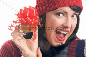 Attractive Woman Holds Holiday Gift Isolated on a White Background.