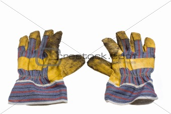 a pair of dirty used work gloves isolated on white background