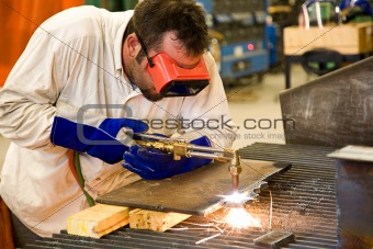Worker in Metal Factory