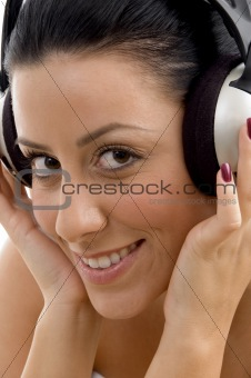 close up of smiling female wearing headphone