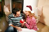 a couple in christmas time - she is holding a gift