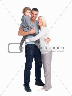 Isolated portrait of a happy young family