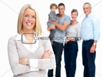 Young woman standing with family in background